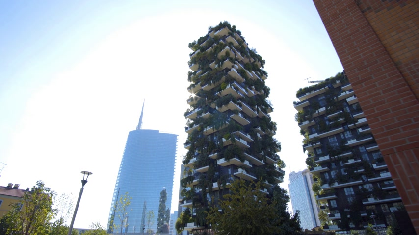 milan : Milan, Italy - September 26, 2018: Modern and ecologic skyscrapers with many trees on every balcony