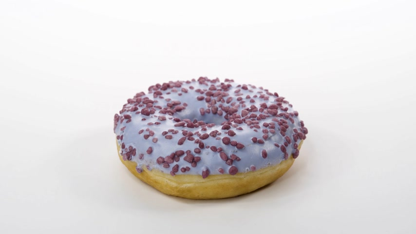 fried : spinning donut with lilac icing on a white background