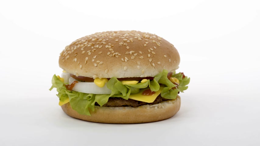 hranolky : Rotation. Appetizing burger on a white background. Dostupné videozáznamy