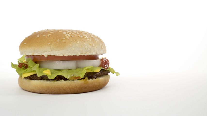картофель фри : Rotation of an appetizing burger on a white background.