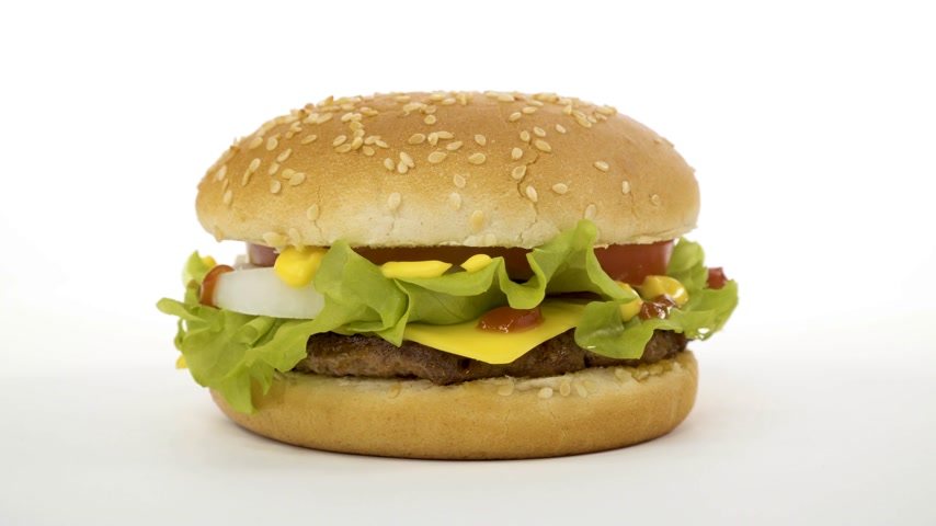 fry : Rotation. Appetizing burger on a white background. Stock Footage