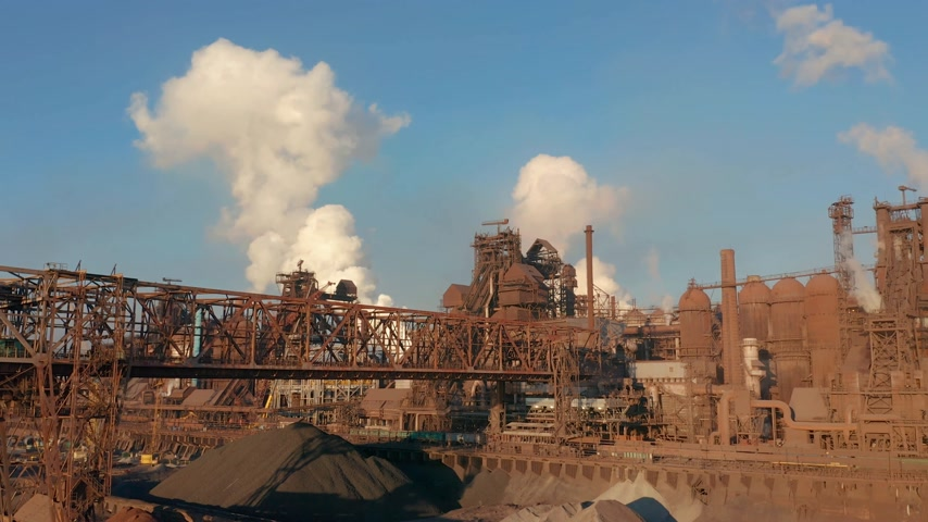 metallurgical plant : Aerial view over industrialized city with air atmosphere and river water pollution from metallurgical plant near sea. Dirty smoke and smog from pipes of steel factory and blast furnaces.