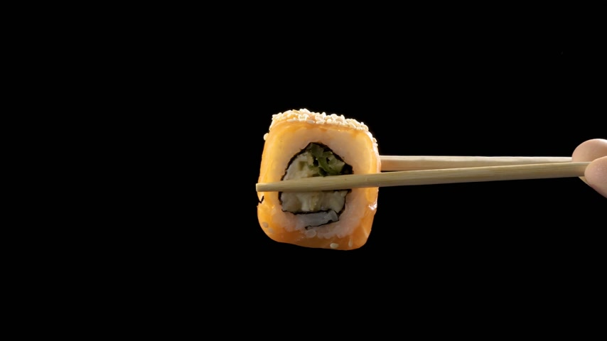 soy : Macro shot of sushi, sashimi, uramaki and nighiri. typical Japanese dish consisting of rice, salmon or tuna, shrimp and fish eggs soaked in soy Stock Footage