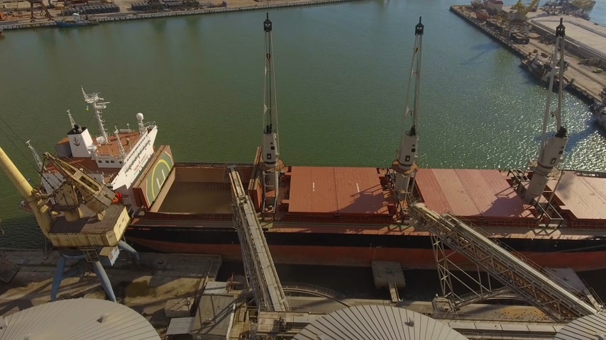 commercial cultivation : Aerial view of big grain elevators on the sea. Loading of grain on a ship. Port. Cargo ship
