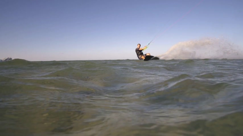 kite boarding : Kitesurfer jumps and splash of water goes into the camera Stock Footage