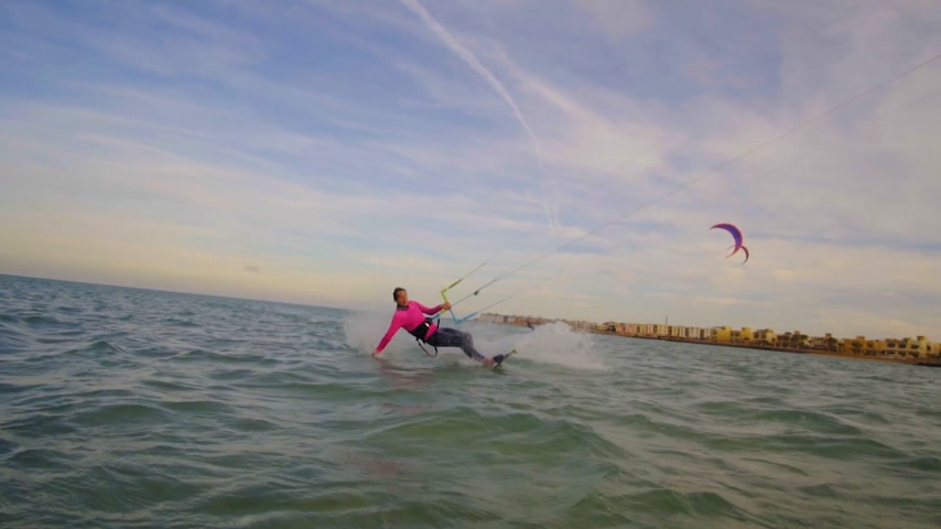 trik : Beautiful young woman kiteboarding at sunset in slow motion, active lifestyle extreme sport Dostupné videozáznamy