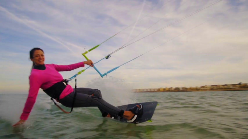 kitesurfer : Beautiful young woman kiteboarding at sunset in slow motion, active lifestyle extreme sport Stock Footage