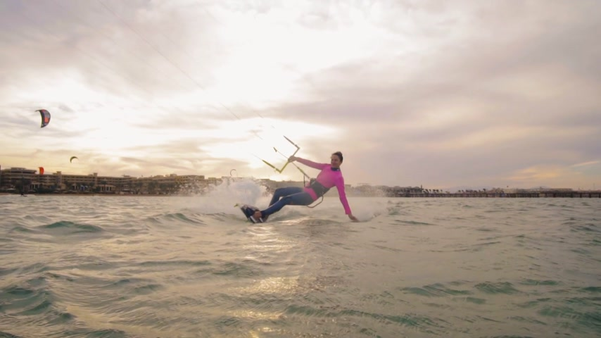 коршун : Beautiful young woman kiteboarding at sunset in slow motion, active lifestyle extreme sport Стоковые видеозаписи