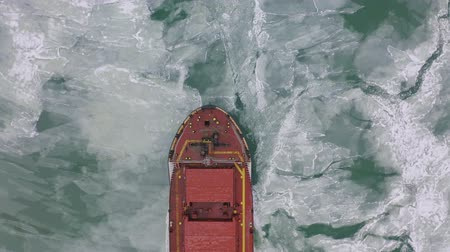 petroleiro : aerial view of the ship slowly moving through ice floes