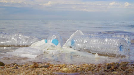 plastics : Pollution: garbages, plastic, and wastes on the beach after winter storms