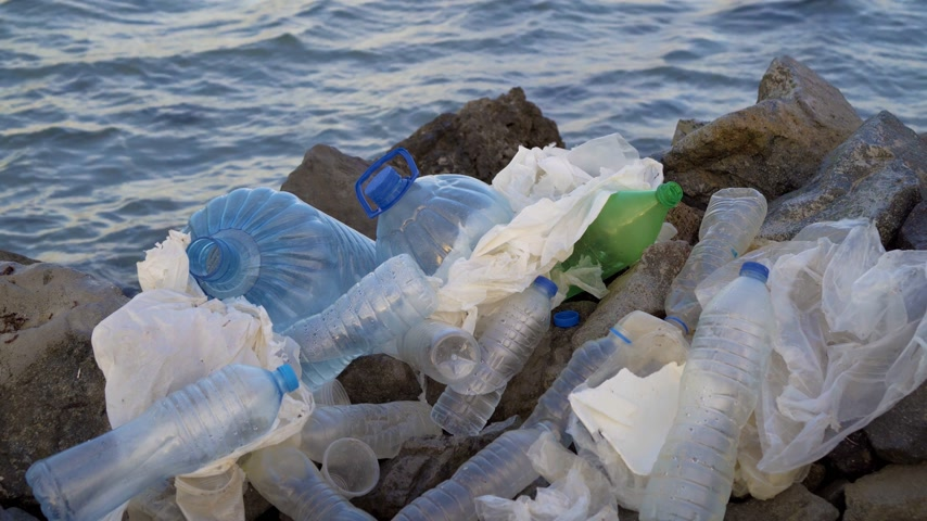 plastics : Plastic pollution in ocean environmental problem. Plastic cups,carrier bags, bottles and straws dumped in sea