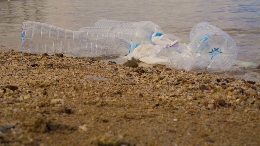 waste water : Plastic pollution in ocean environmental problem. Plastic cups,carrier bags, bottles and straws dumped in sea