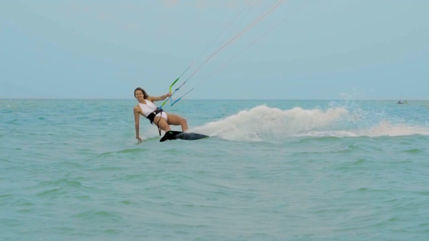 uçurtma : Young girl Kite Surfing In Ocean, Extreme summer sport slow motion