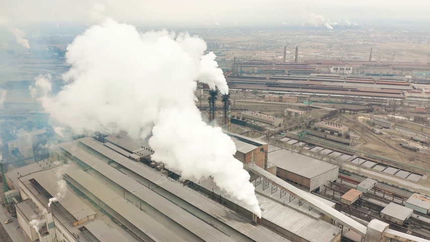 cooling tower : Industrial zone with a large red and white pipe thick white smoke is poured from the factory pipe. Pollution of the environment: a pipe with smoke. Aerial view Stock Footage