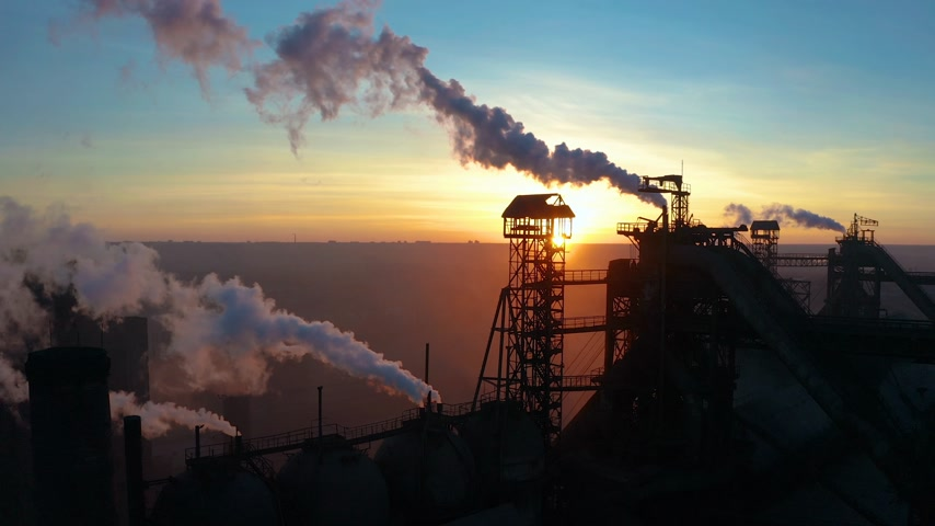 mist : Blast furnace view from the air. Old factory. Aerial view over industrialized city with air atmosphere pollution from metallurgical plant.