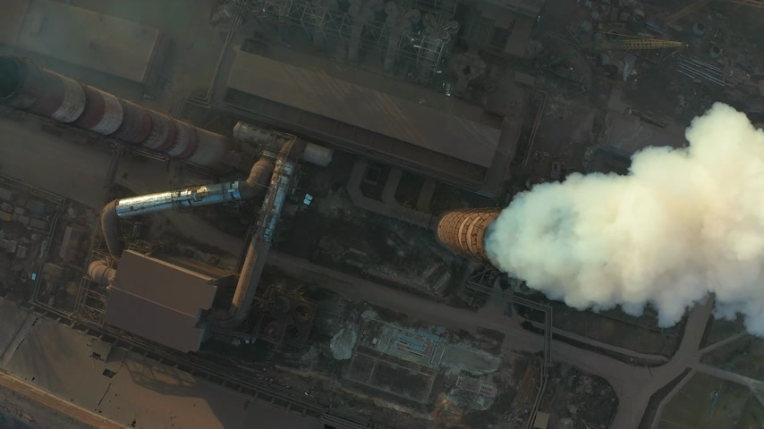 výfuk : Aerial view. Emission to atmosphere from industrial pipes. Smokestack pipes shooted with drone