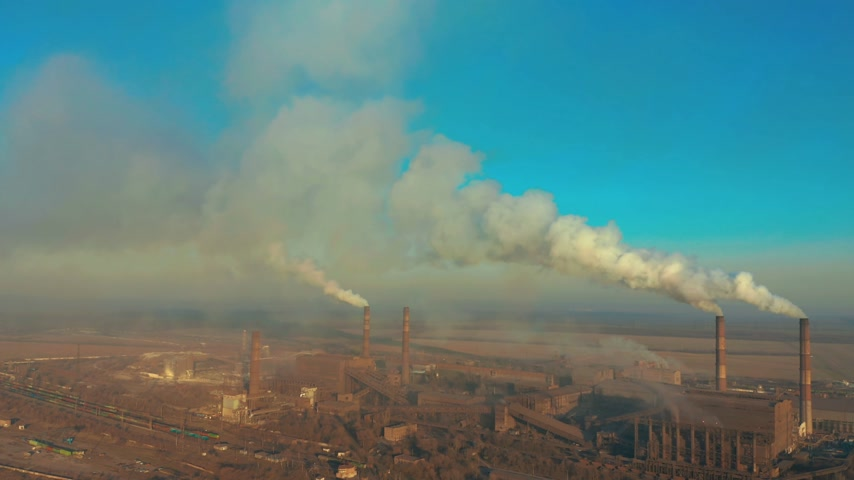 emissions : Aerial view. Emission to atmosphere from industrial pipes. Smokestack pipes shooted with drone