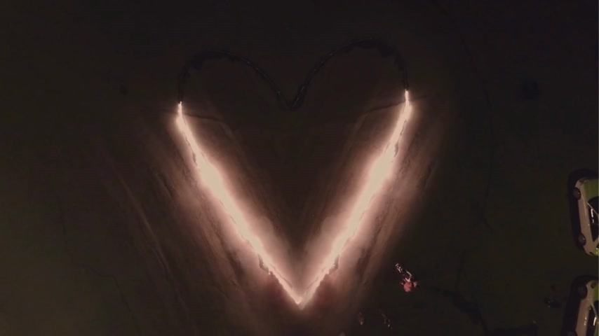 ignite : Aerial view. Burning heart of love. Fire show.