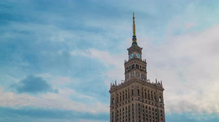 warszawa : Time lapse of the spire of Palace of Culture and Science, historic high-rise building in the centre of Warsaw, Poland Stock Footage