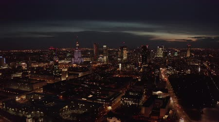 центральный : 4K. Aerial shot of Warsaw city metropolis skyline at night. Spectacular aerial view of skyscraper city buildings at night. Стоковые видеозаписи