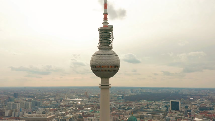 berlin skyline : Berlin TV Tower super closeup during a cloudy day, aerial view