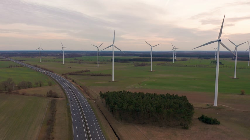 clean electricity production : Windmill Wind power technology - Aerial drone view on Wind Power, Turbine, Windmill, Energy Production - Green technology, a clean and renewable energy solution.