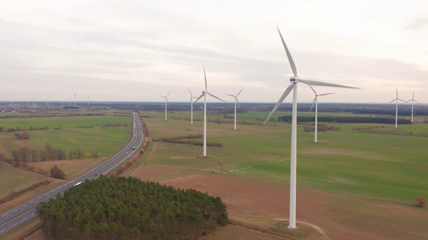 sustentável : Wind turbines and agricultural fields on a summer day - Energy Production with clean and Renewable Energy - aerial shot.