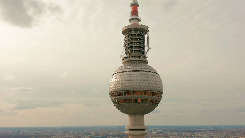 berlin skyline : BERLIN, GERMANY - MARCH 28, 2019. Berlin TV Tower super closeup during a cloudy day, aerial view Stock Footage