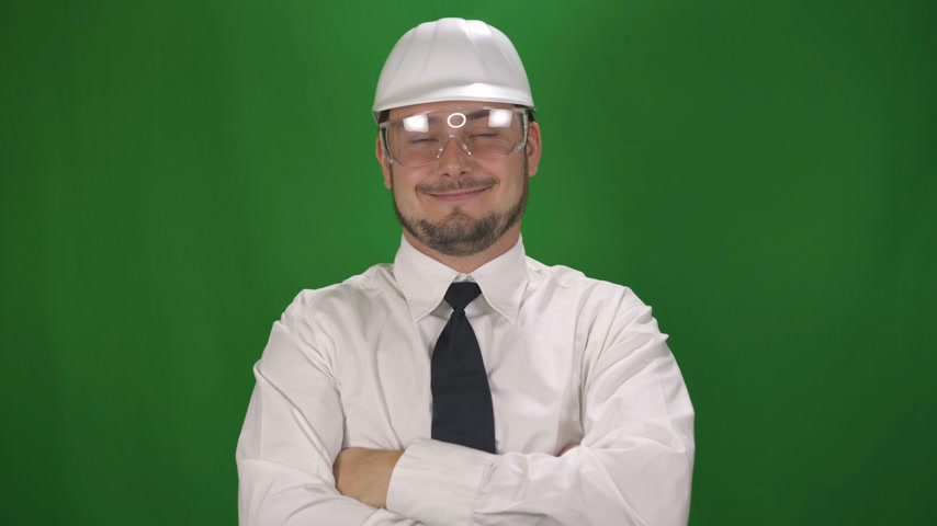 padrone : Portrait of Business Worker Man in the white helmet. Green Screen Background Filmati Stock