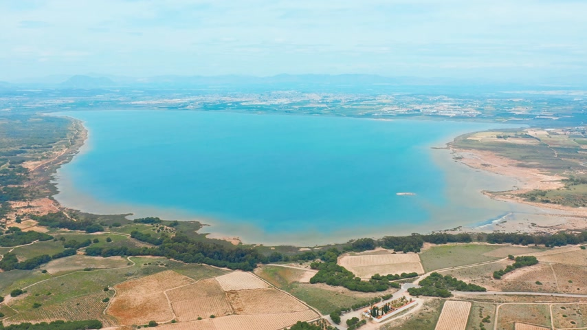 塩辛い : Flying drone over the salt lake near the town of Torrevieja in Spain.