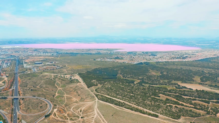 Коста : Panoramic aerial view video of Las Salinas, bright color famous place pink lake. coastline of Torrevieja city and Mediterranean Sea. Costa Blanca. Province of Alicante. Spain