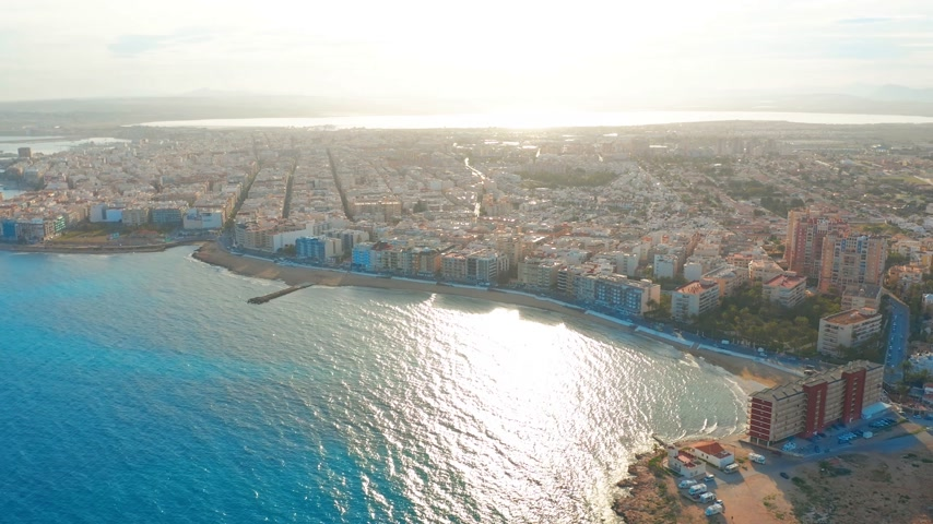 Коста : aerial view of beach and coast, Costa blanca coast, sunset Стоковые видеозаписи