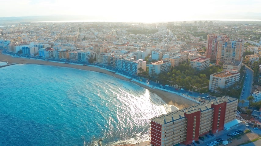 földközi tenger : aerial view of beach and coast, Costa blanca coast, sunset Stock mozgókép