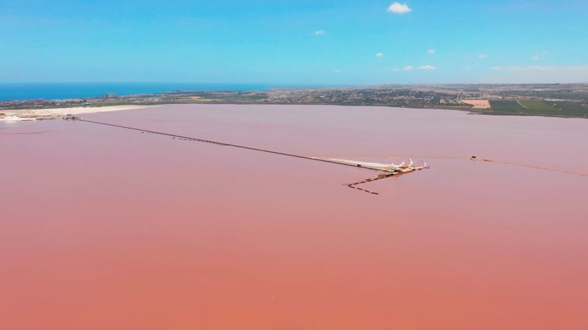salt lagoon : Panoramic aerial view video of Las Salinas, bright color famous place pink lake. Coastline of Torrevieja city and Mediterranean Sea. Costa Blanca. Province of Alicante. Spain. Stock Footage