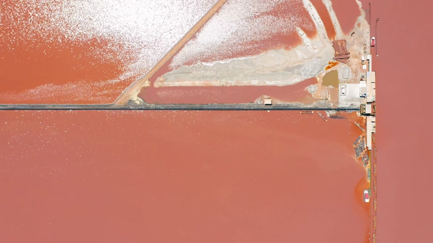 salamura : Aerial view of salt sea water evaporation ponds with pink colour.