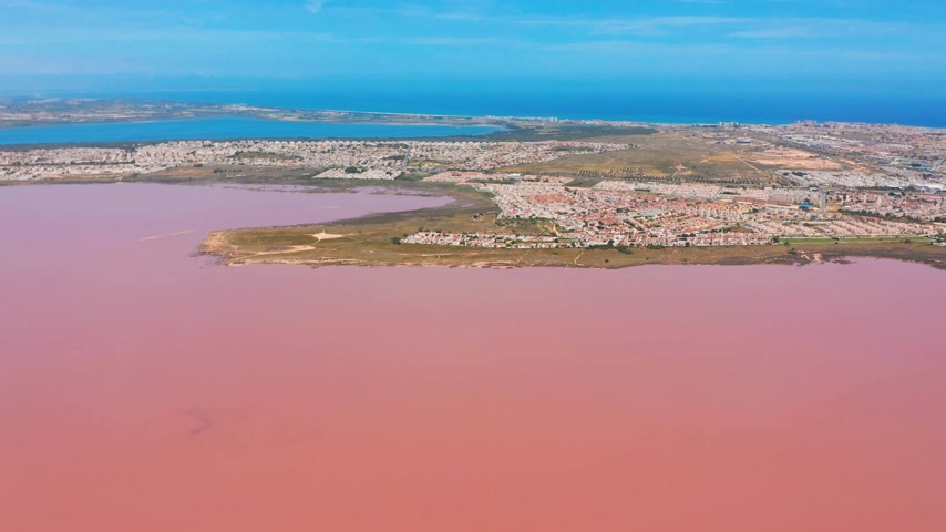 salt lagoon : Aerial view. Salt sea water evaporation ponds with pink colour.
