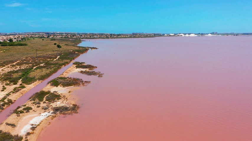 salt marsh : Aerial view. Salt sea water evaporation ponds with pink colour.