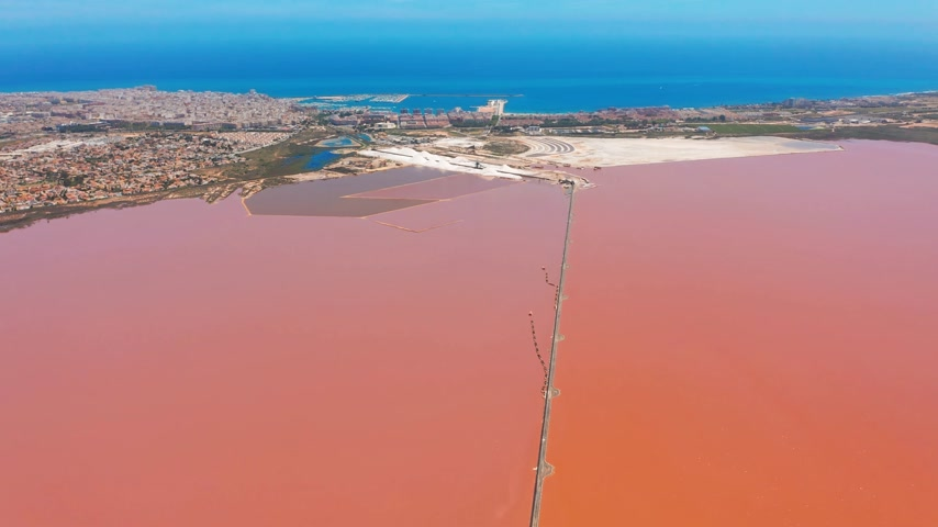 salt lagoon : Aerial view of salt sea water evaporation ponds with pink colour.