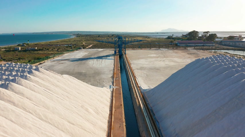 andy : Aerial view of industrial extraction of salt in the desert, pile of salt.