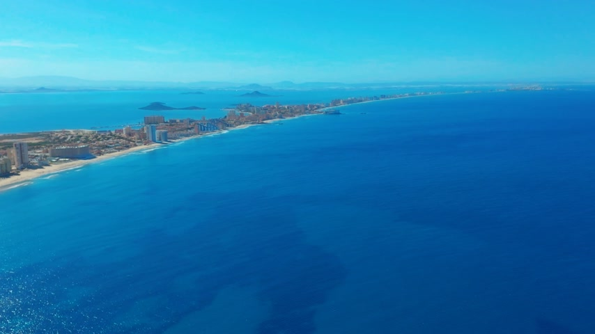 манга : Aerial view. Flight over gorgeous islands, long spit La-Manga,Spain, beautiful azure sea and hills.