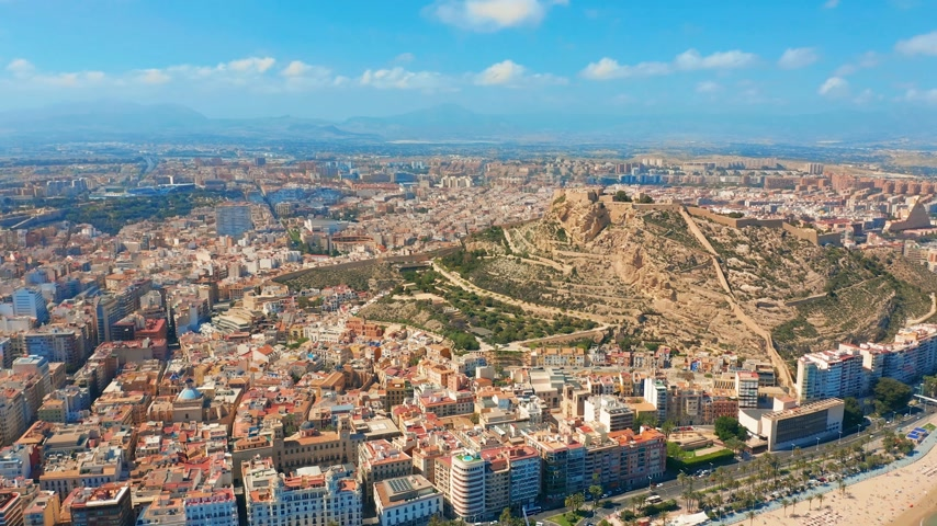 Коста : Alicante, Spain. Aerial view on the city against the sea with a view of the mountain and fortress.