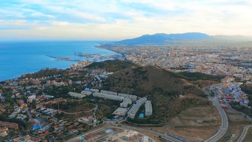 malaga : Aerial view of Malaga Costa del sol with the sea and mountains surrounding it.