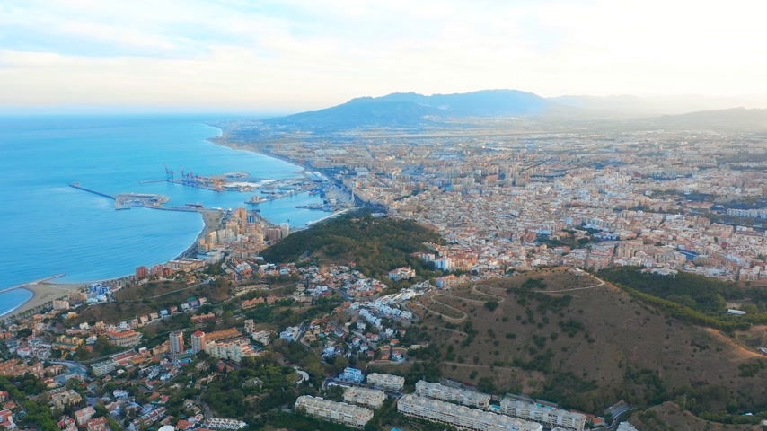 malaga : Malaga, Spain. A panorama shot by a drone over Malaga. City buildings and seaside view. Ships and port.