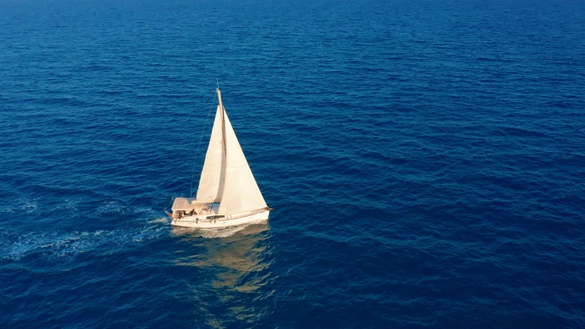 marinai : Aerial view. Beautiful view of Yacht saile in open sea. Filmati Stock