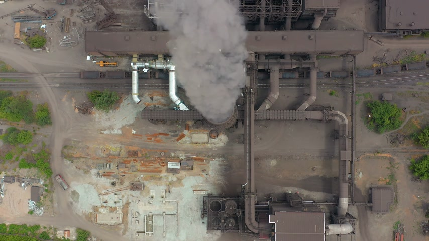 emissions : Aerial view. Dirty smoke and smog from pipes of steel factory and blast furnaces. Stock Footage