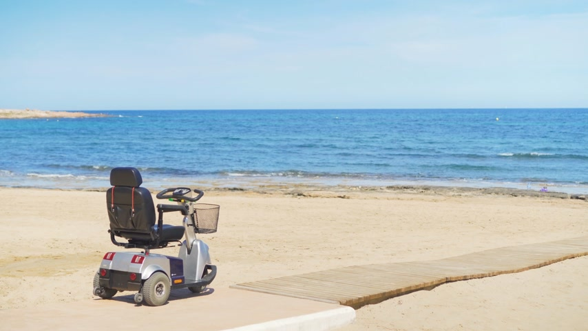 tesisler : Electric wheelchair on the beach background the sea.