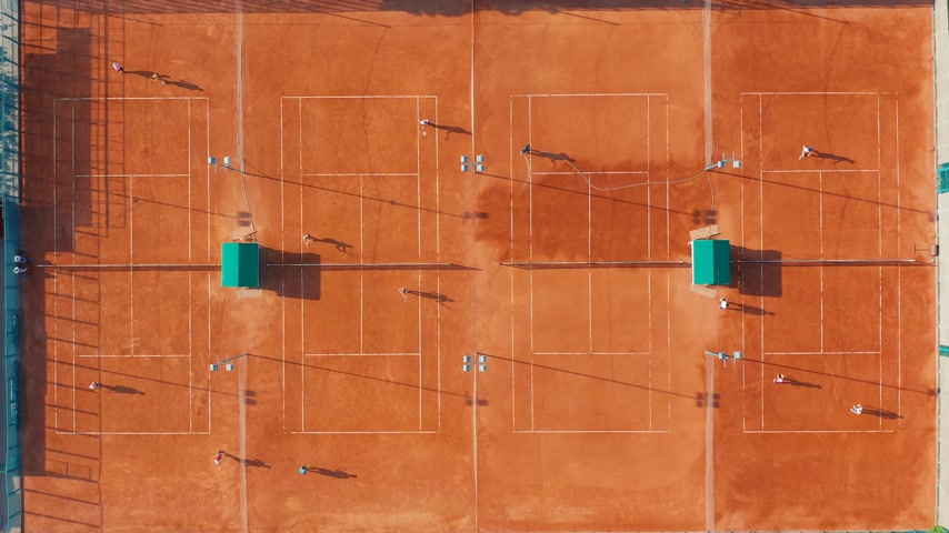 upward : Aerial view of tennis court during a match.