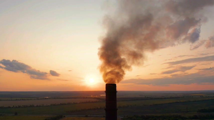 cooling tower : Aerial view. Industrial pipe pollute the air next to people living in the city. Stock Footage