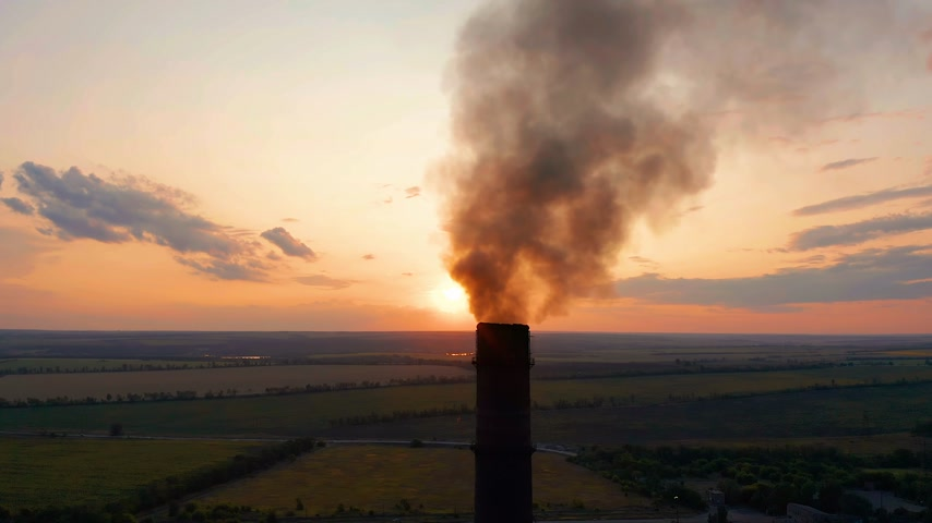 emissions : Aerial view. Pipes throwing smoke in the sky. Air pollution from Industrial plants.