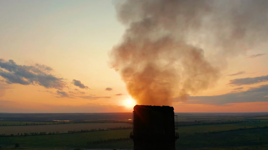 cooling tower : Aerial view. Pipes throwing smoke in the sky. Air pollution from Industrial plants.